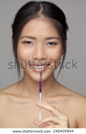 Closeup of botox injection and woman - stock photo