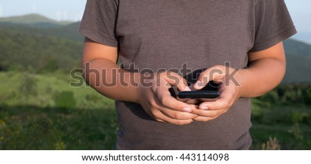 Closeup of boy hands holding mobile phone  - stock photo