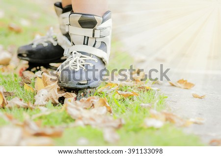 Closeup of boy is standing with roller blade, selective focused. - stock photo