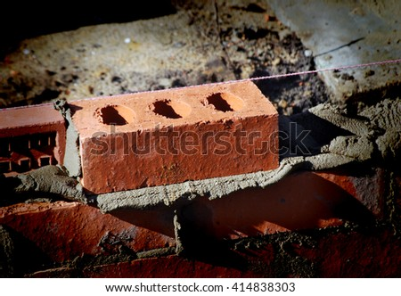 Closeup of bricks during the building of a house extension with vignette effect.