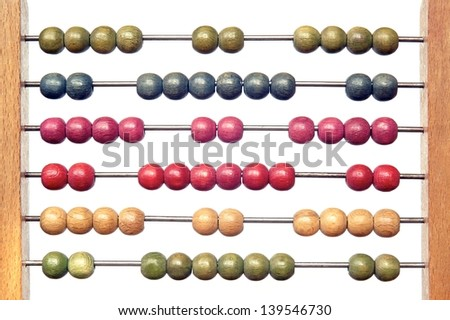 Closeup of bright abacus beads on white background - stock photo