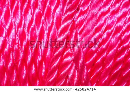 Closeup of Brightly colored nylon cord on a spool - Pink - stock photo