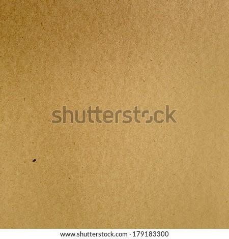 Closeup of brown cardboard texture - stock photo