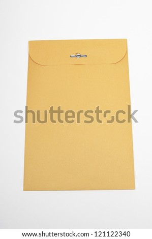 Closeup of brown confidential paper folder over white background - stock photo