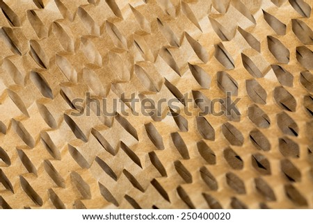 Closeup of brown paper packaging, cut to create a mesh - stock photo