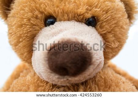 Closeup of brown stuffed teddy bear - stock photo