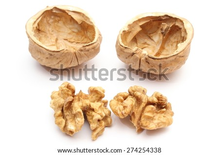 Closeup of brown walnut without shell and nutshells. Isolated on white background - stock photo