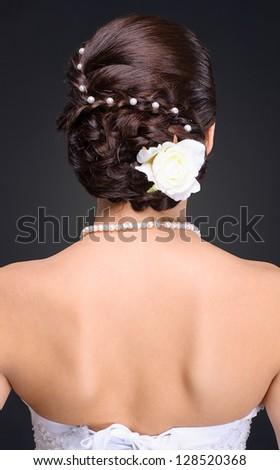 closeup of brunette bride hairstyle in studio - stock photo