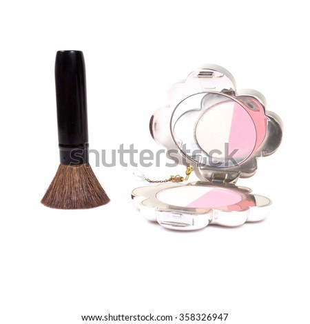 closeup of brush and face powder isolated on white.