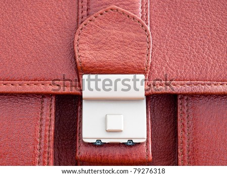 Closeup of buckle on leather business case. - stock photo