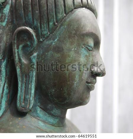 Closeup of Buddha - stock photo