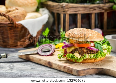 Closeup of burger made �¢??�¢??from beaf and fresh vegetables - stock photo