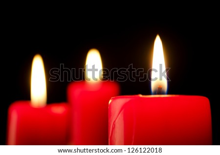 Closeup of burning red candles - stock photo