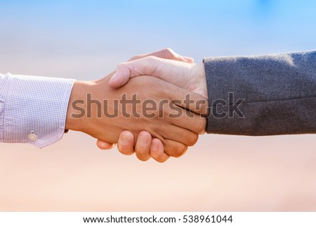 Closeup of business people handshake standing for trusted partnership