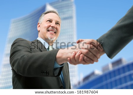 Closeup of business people shaking hands - stock photo