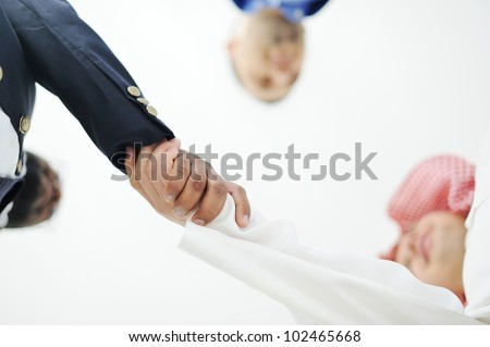 Closeup of business people shaking hands over a deal somewhere in the Middle east