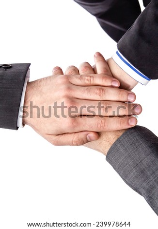 Closeup of business team showing unity with hands together isolated on white background - stock photo