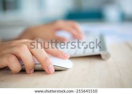 Closeup of business woman hand typing on keyboard and mouse - stock photo