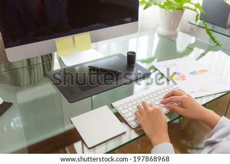 Closeup of business woman hand typing on keyboard computer - stock photo