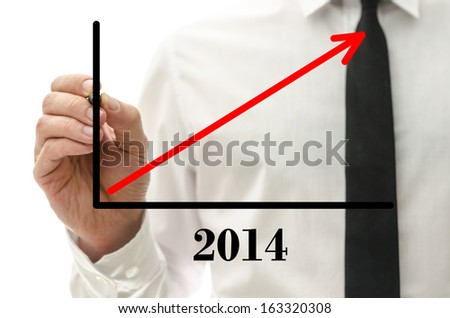 Closeup of businessman drawing growing financial graph for year 2014. - stock photo