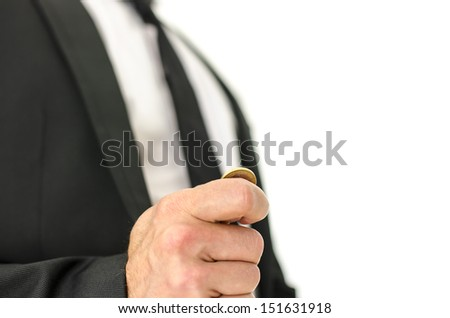 Closeup  of businessman hand flipping  a coin. Isolated over white background. - stock photo