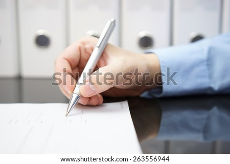 closeup of businessman hand with pen when signing document. Business concept - stock photo