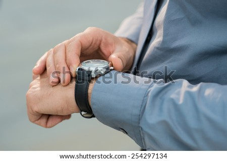 Closeup Of Businessman Hands Checking Time - stock photo