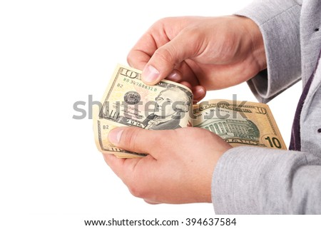 Closeup of businessman  hands counting dollar banknotes; isolated over white background - stock photo