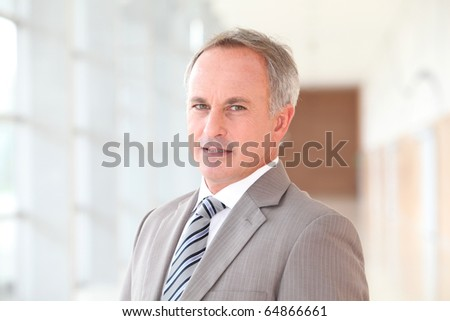 Closeup of businessman in grey suit - stock photo