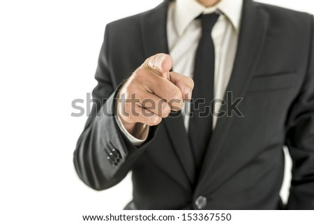 Closeup of businessman pointing finger at you. Isolated over white background. - stock photo