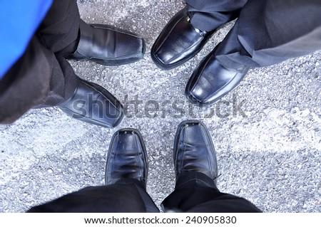 Closeup of businessman's legs on the pavement  - stock photo