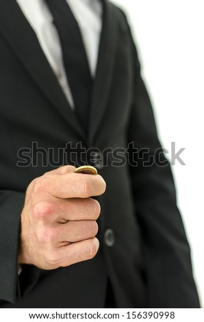 Closeup of businessman tossing a coin. Concept of decision making. - stock photo