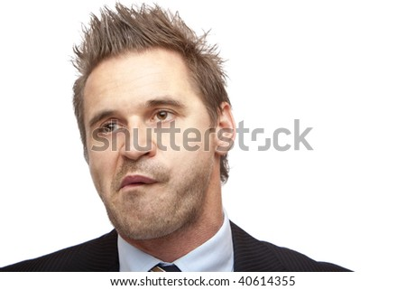 Closeup of businessman which looks board on white background - stock photo