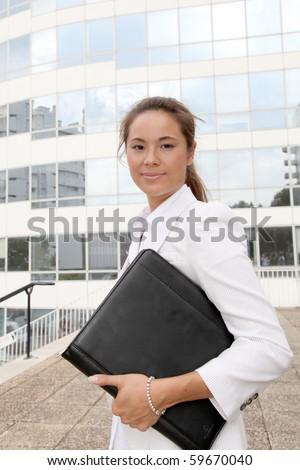 Closeup of businesswoman holding notebook - stock photo