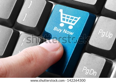 Closeup of buy now button on the keyboard - stock photo