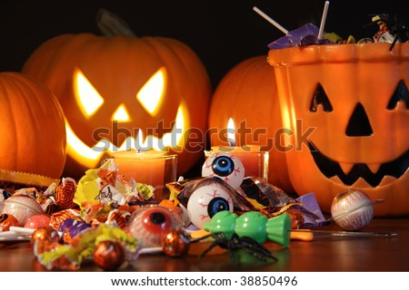 Closeup of candies with pumpkins after Halloween festivities - stock photo
