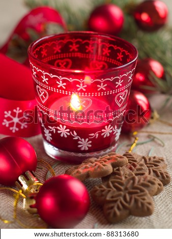 Closeup of candles with Christmas decoration, selective focus