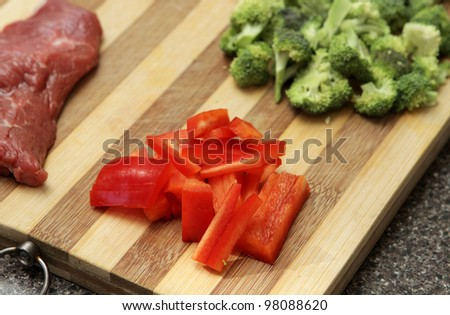 closeup of capsicum for stir fry chopped with broccoli and steak - stock photo