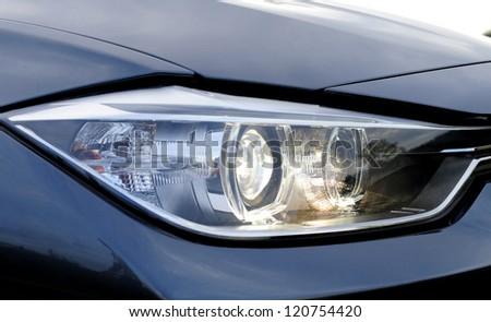 Closeup of car headlight - stock photo