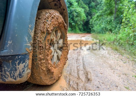 Closeup of car wheel on dirt road