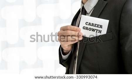 Closeup of career adviser taking his business card out of a jacket pocket. Conceptual of personal growth and fulfillment of ones business aims and ambitions. - stock photo