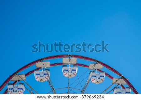 Closeup of Carnival Ferris Wheel with Clean Skies Close up shot of half of a ferris wheel in Coachella California. - stock photo