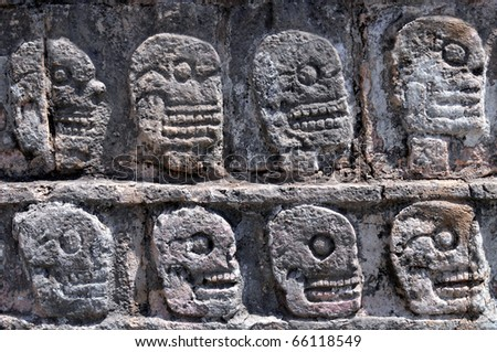 Closeup of carved skulls in a Mayan temple in Chichen Itza, in Mexico - stock photo