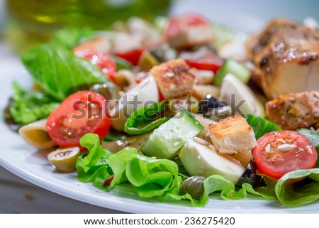 Closeup of cesar salad with vegetables - stock photo