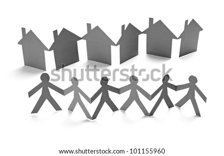 closeup of chain of paper people and houses cut on white background - stock photo