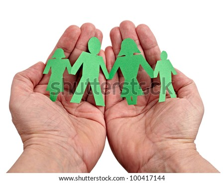closeup of chain of paper people in hands on white background - stock photo