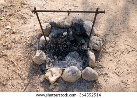 closeup of charcoal in grill with grate - stock photo