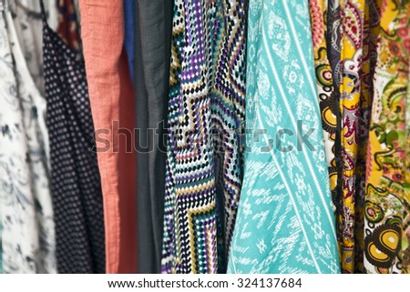 Closeup of cheap scarves and cloth in marketplace - stock photo