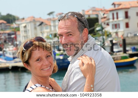 Closeup of cheerful senior couple in vacation - stock photo