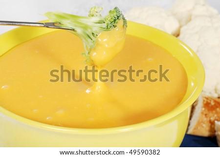 closeup of cheese fondue with broccoli - stock photo